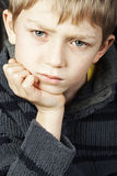 Criança loura séria Fotografia de Stock