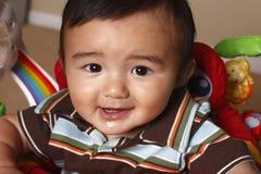 Criança na cadeira com brinquedos Fotografia de Stock