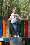 Criança na camisa ucraniana do estilo em um balanço Fotografia de Stock