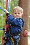 Criança na corda alta fotos de stock royalty free