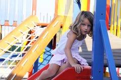 Criança na corrediça Foto de Stock Royalty Free