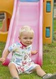 Criança na corrediça Fotos de Stock Royalty Free