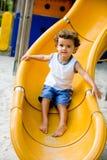 Criança na corrediça Imagem de Stock Royalty Free