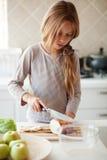Criança na cozinha Fotos de Stock Royalty Free