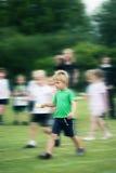 A criança na escola ostenta o dia Fotografia de Stock