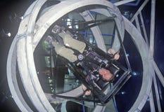 Criança na máquina antigravitante do exercício no acampamento do espaço, George C Marshall Space Flight Center, Huntsville, AL fotografia de stock