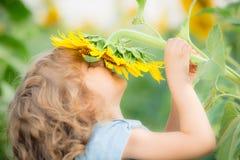 Criança na mola Foto de Stock Royalty Free
