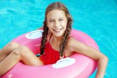 Criança na piscina Foto de Stock Royalty Free