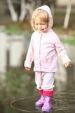 Criança na poça Imagens de Stock