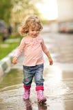 Criança na poça Imagem de Stock Royalty Free