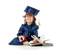 Criança na roupa do academician com livro imagem de stock royalty free