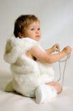 Criança na roupa do inverno Foto de Stock Royalty Free