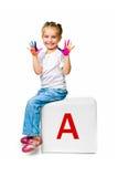 Criança no bloco com letra Imagem de Stock Royalty Free
