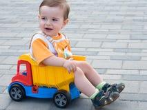 Criança no caminhão Fotos de Stock