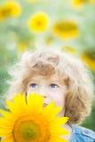 Criança no campo da mola Imagem de Stock Royalty Free