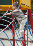 Criança no campo de jogos Foto de Stock Royalty Free
