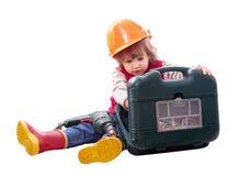 Criança no capacete de segurança com ferramentas de funcionamento Imagens de Stock