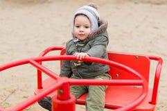 Criança no carrossel Foto de Stock