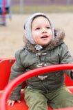 Criança no carrossel Fotografia de Stock