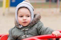Criança no carrossel Imagem de Stock