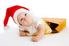 Criança no chapéu do Natal Imagens de Stock Royalty Free