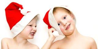 Criança no chapéu do Natal. Colagem Fotos de Stock