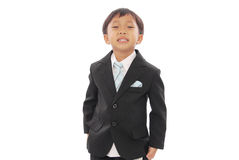 Criança no desgaste do negócio fotografia de stock