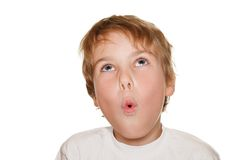 Criança no estúdio branco da fotografia, perplexidade Fotografia de Stock