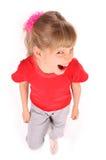 Criança no grito vermelho do t-shirt. Imagem de Stock