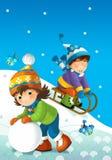 A criança no inverno no pequeno trenó Foto de Stock