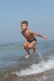 Criança no movimento Imagem de Stock Royalty Free