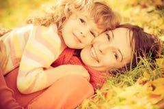 Criança no outono Foto de Stock Royalty Free