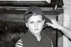 Criança no tampão Foto de Stock Royalty Free