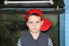 Criança no tampão Imagem de Stock