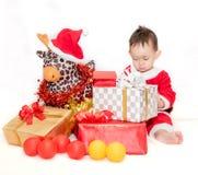 Criança no terno de Santa Claus Fotografia de Stock