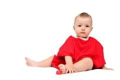 Criança no vermelho Imagens de Stock Royalty Free