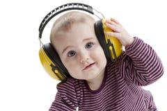 Criança nova com protector auricular Imagem de Stock Royalty Free