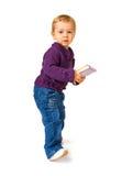 Criança nova com um livro fotografia de stock royalty free