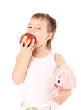 Criança nova que come uma maçã imagem de stock royalty free