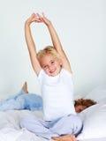 Criança nova que estica após o sono Imagem de Stock Royalty Free
