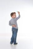 A criança olha seu professor Fotos de Stock Royalty Free