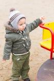 Criança pelo carrossel Fotos de Stock