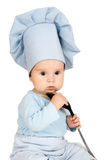 Criança pequena com concha do metal e chapéu do cozinheiro Foto de Stock Royalty Free