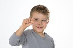 Criança pequena com expressão esperta Imagem de Stock