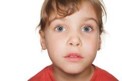 Criança pequena no estúdio, cabeça do retrato acima Fotografia de Stock