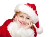A criança pequena vestida como Papai Noel sorri feliz Fotos de Stock