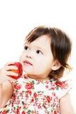 A criança prova a maçã Imagens de Stock Royalty Free
