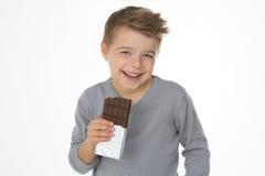 Criança que aprecia seu doce do favorito Foto de Stock Royalty Free