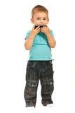 Criança que beija um telefone de pilha Fotografia de Stock Royalty Free
