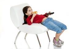 Criança que come a pizza Foto de Stock